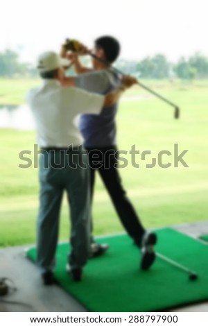 Blurry focus scene of golf course master trainer teaching action represent the golf sport course concept related idea.