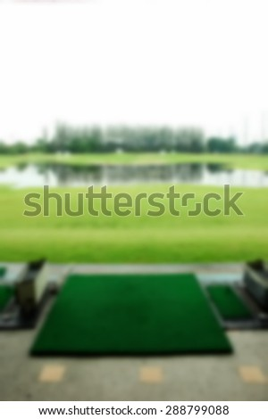 Blurry focus scene of golf driving range represent the golf sport course concept related idea.