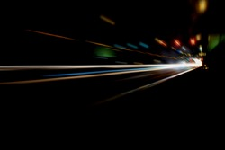 Blurry Illumination and night lights, car traffic motion blur the speed and dynamics