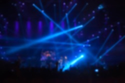 blurry image background of musicians rock in big rock concert.