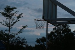 Blurry image,Basketball hoop At the basketball practice court of a rural hospital in the sunset.