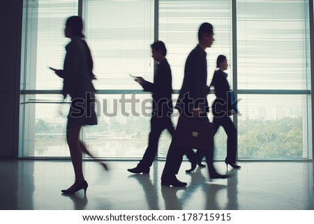 Blurry image of a business team during a rush hour