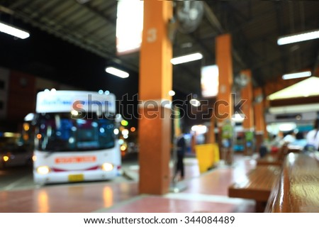 blurry image of Bus station at night