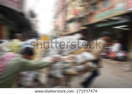 Blurry image of people at street market in India in sunny day, blur background with zooming effect in Chandni Chowk, India - Shutterstock ID 271937474
