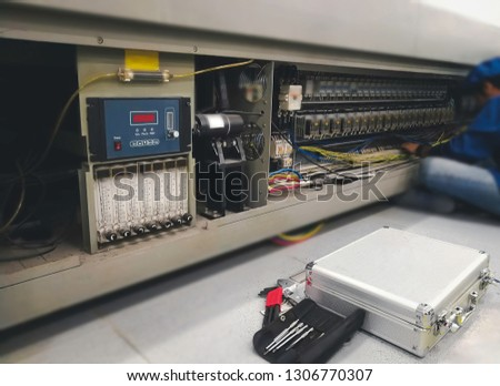 Blurry images are not clear of place on tool and machine for maintenance at Surface mount technology (SMT) for manufacturing of electronic equipment, blur background