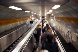 Blurry motion image of people on a escalator in Istanbul subway.