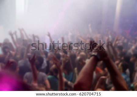 Blurry night club dj party people enjoy of music dancing sound with colorful light. club night light dj party Ibiza club. With Smoke Machine and lights. Dark background. #620704715