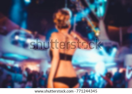 Blurry night club dj party people enjoy of music dancing sound with colorful light. club night light dj party. With Smoke Machine and lights. Dark colored background #771244345