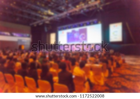 blurry of group of people in big hall convention center