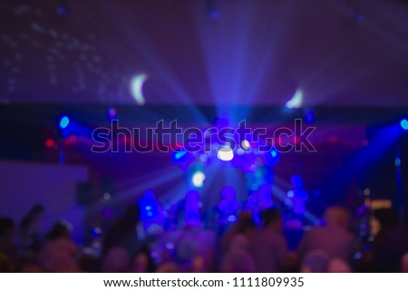 Blurry of light and shadow,The colorful party of New Year's Eve celebrates the people who are enjoying the music and celebrating friendship and business success. Happy party concept #1111809935