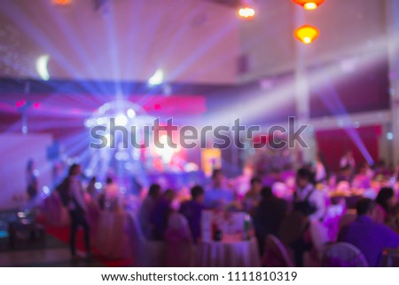 Blurry of light and shadow,The colorful party of New Year's Eve celebrates the people who are enjoying the music and celebrating friendship and business success. Happy party concept #1111810319
