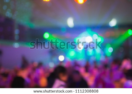 Blurry of light and shadow,The colorful party of New Year's Eve celebrates the people who are enjoying the music and celebrating friendship and business success. Happy party concept #1112308808