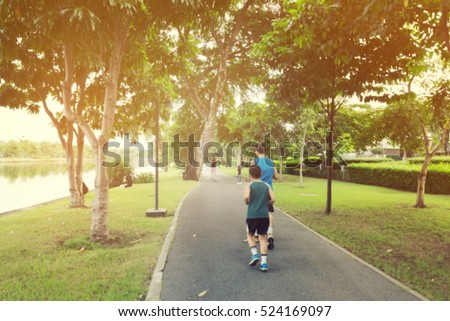 Blurry Picture of Asian Family are Running in Outdoor Public Park Background - Lifestyle Sport Recreation Concept