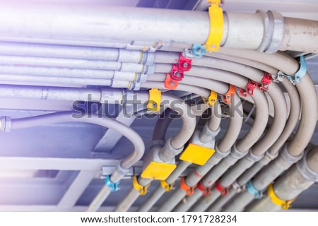 Blurry picture of electrical conduit and cabling. Blurry image for construction background. The rows of electrical conduit and signal cables in the parking building. Stock photo ©