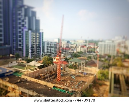 Blurry picture of resident construction because increase people in the city and growth business concept #744709198
