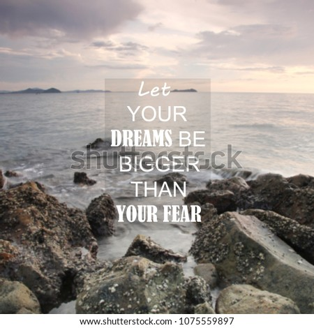 Blurry seascape with Inspirational quote - Let your dreams be bigger than your fear #1075559897