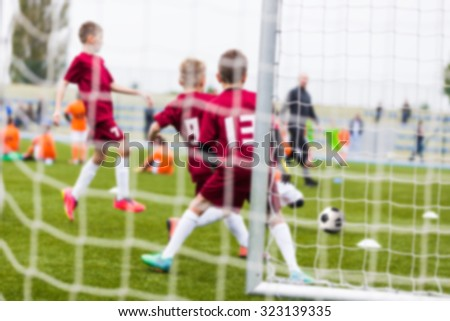 Blurry sport background of football soccer match. Training and game for children.