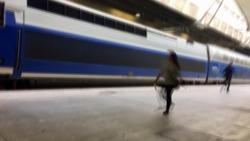 blurry train station platform people silhouettes