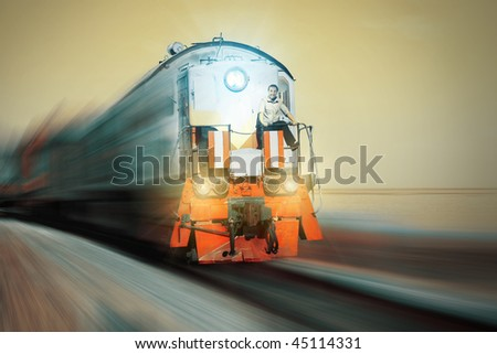 Blurry train with crazy driver on front