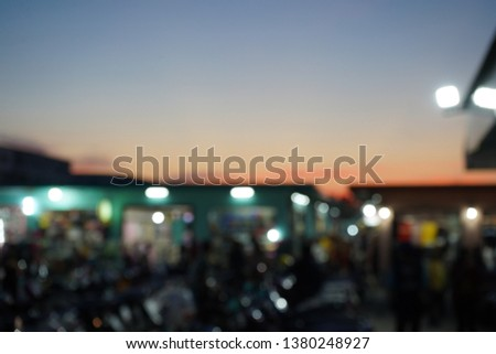 Blurry View market sunset background. #1380248927