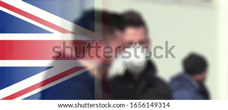 Blurry view of british people wearing  protecting mask. One laboratory-confirmed case of the novel coronavirus (COVID-19) has so far been diagnosed in England Stok fotoğraf ©