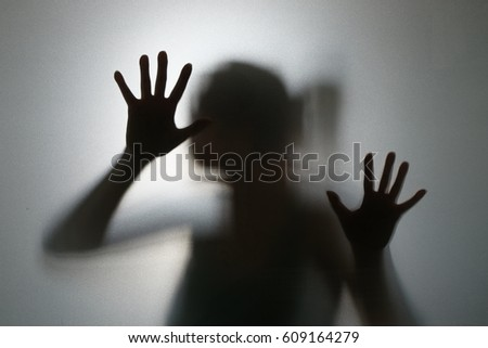 Shadowy figure behind glass Stock Photo 312741854 - Avopix com
