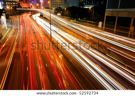 Blurs of night city traffic streams