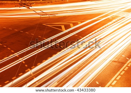 Blurs of night city traffic streams with red and white lights on long exposure