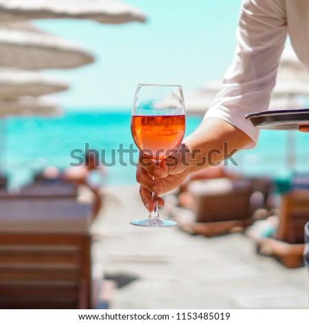 Blush wine served in a beach #1153485019