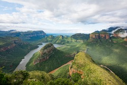 Blyde river canyon on a cloudy day with a rainbow coming through
