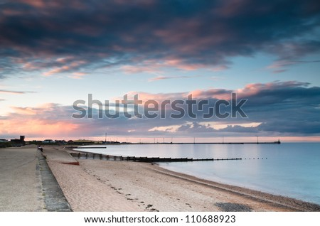 Blyth harbour at sunset / Western sunset shining on easterly clouds at Blyth beach