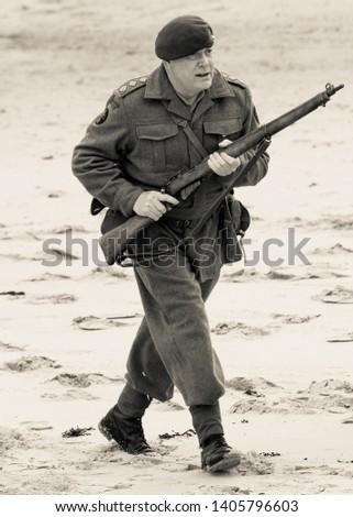 Man with AK-47 handgun and RPG bazooka… Stock Photo