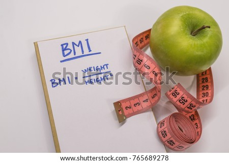 BMI body mass index formula rate in a notepad. BMI. Note written: BMI (body mass index) formula, health conceptual. Concept BMI body mass index formula rate formula, fitness and weight loss.