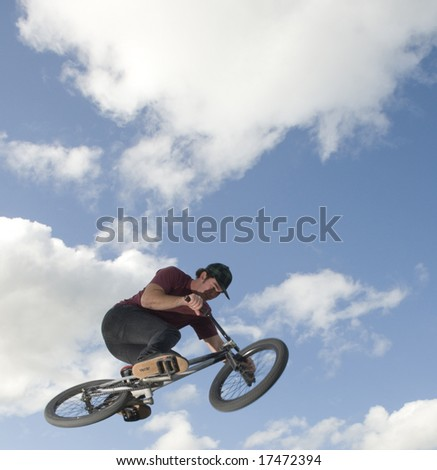 BMX jumps over lip