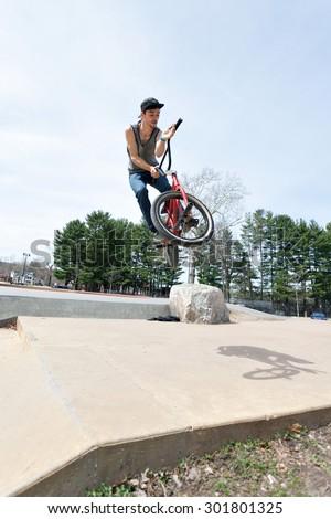 BMX rider athlete spinning his handle bars mid air.
