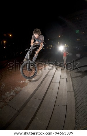 BMX rider performing air trick \
