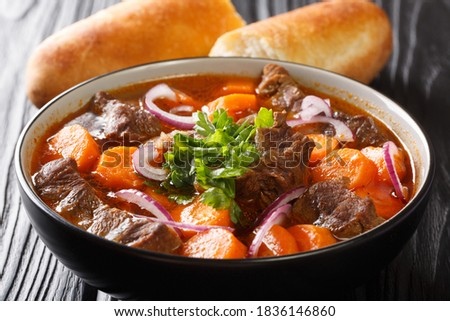 Bo Kho recipe this Vietnamese beef stew has all the flavors of a traditional beef stew with additional aromatics from lemongrass and star anise closeup in bowl on the table. Horizontal Foto stock ©