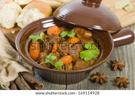 Bo Kho - Vietnamese beef stew cooked with lemongrass, star anise, bay leaf and cassia bark served with crusty bread.