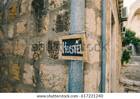 Board for inscriptions on the wall of a building in Montenegro. A chalk written inscription Hostel . #617231240