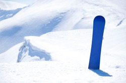 board for snowboarding in the snow on background snowy mountains of Europe