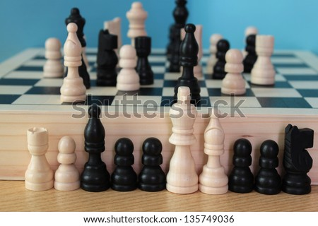 board game with wooden pawns in chess and checkers