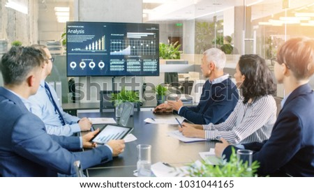 Board of Directors Has Annual Meeting, Diverse Group of Business People in the Modern Conference Room Discuss Statistics and Work Results. In the Background Projector Showing Company Growth.