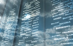board of list countries with a sky reflection . flight information board at airport. travel concept