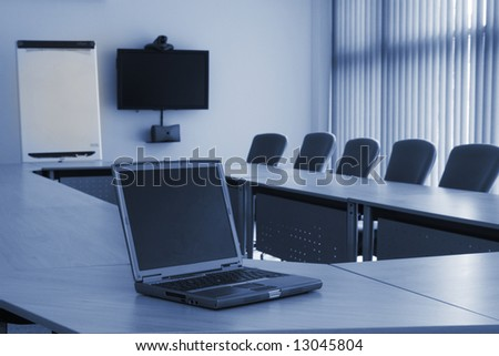 Board room in office block with laptop and video conferencing equipment