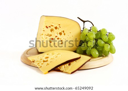 board with cheese and grapes