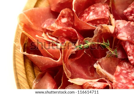 Board with thinly sliced �¢??�¢??salami and jamon