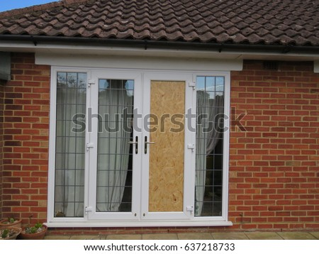 Boarded up French Windows after a break in