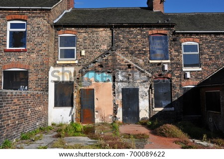 boarded up terraced houses in...