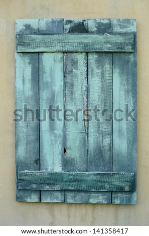 Boarded up window of old house