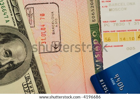 Boarding pass, entry stamps & visa in passport page, money, credit card